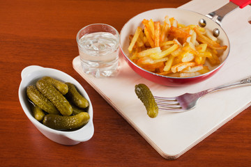 fried potato with cucumbers