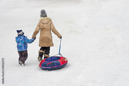 Family having fun on the snow