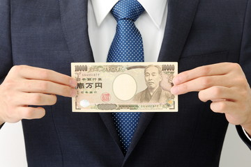お金を持つビジネスマン