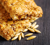 Oat granola bars on wooden table