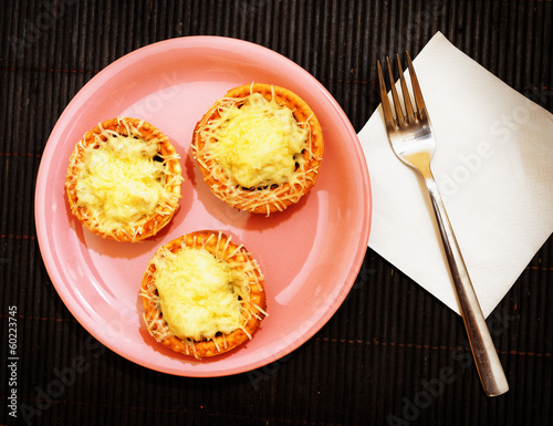 Cheese tartlets on a plate