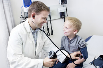 Doctor Examining cute little boy
