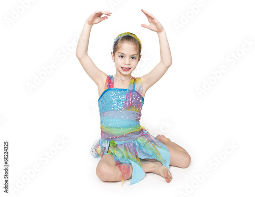 Cute little dancer girl isolated on white background