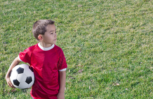 Young Hispanic Soccer Player on Grass field