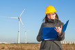 Female Engineer in a Wind Turbines Farm