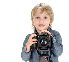 little boy with camera on tripod on white background