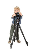 little boy with camera on tripod full length on white background