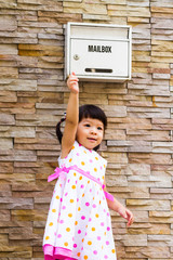little girl and mailbox