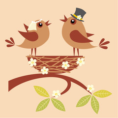 Birds bride and groom are singing about their love in a nest.