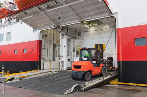 Big passenger ship loading with lift truck