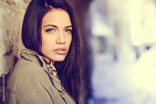 Young woman with green eyes in urban background © javiindy