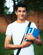Arab male student with books outdoors