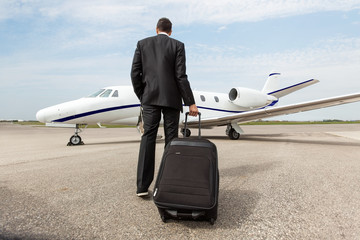 Businessman Walking Towards Corporate Jet