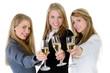 three women holding glasses