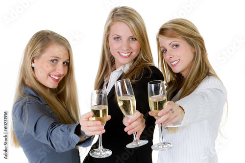 three women holding glasses