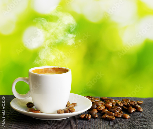 Foto op Plexiglas Cafe Cup of coffee on nature background