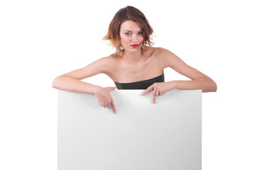 Beautiful brunette behind billboard paper poster
