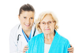 Doctor And Senior Woman Against White Background