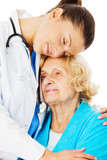 Doctor Embracing Senior Woman Over White Background