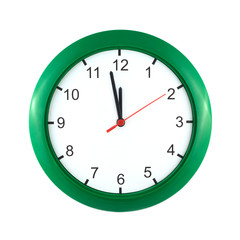 Big wall clock shows almost twelve o'clock isolated close up
