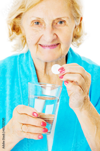 Senior Woman Holding Water Glass And Tablet