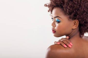 african woman looking over her shoulder