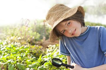 child explores nature