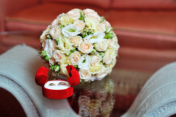 Pair of wedding rings and wedding bouquet