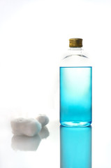 isopropyl alcohol bottle and cotton wool
