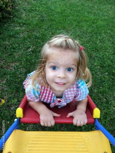 cute child having fun playing outdoors