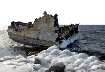 Old ruined-ship tossed on the sea shelf