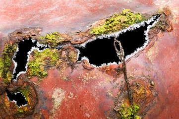 Detail of old rusted sheet metal pots
