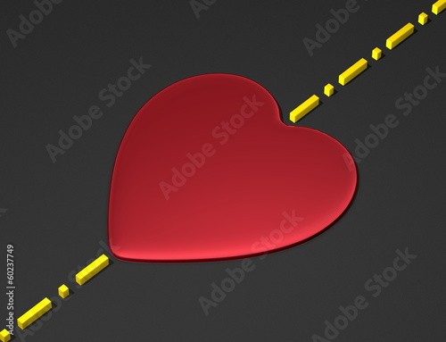Red heart on black surface with boundary line