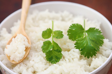 Steam rice with wood spoon