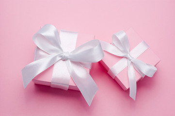 Two Pink Valentines Day gift box tied white satin ribbon bow