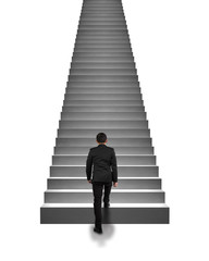 Rear view businessman climbing on stairs isolated in white