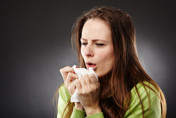 Woman with flu coughing