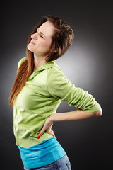 Young woman having a severe lumbar pain