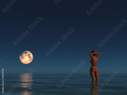 Moon over the sea and a woman