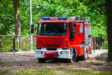 A fire truck while fetching water. Polish Fire Department. poster