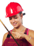 Female construction worker holding saw