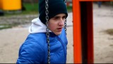 Sorrowful teenage boy swinging in the park episode 3