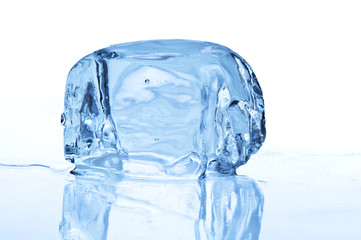 Melting ice block on white background