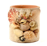 Vase with seashell decorate isolated