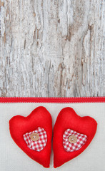 Valentine card with textile hearts on canvas