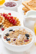 muesli with milk, waffles with berries, toast and jam