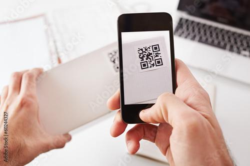 Smartphone taking photo of QR code