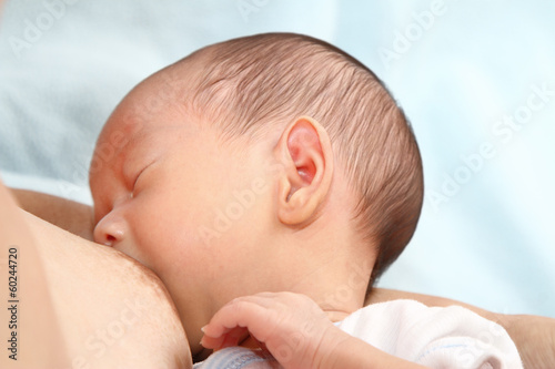 A baby boy being breastfed