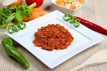 Ragout and vegetables in a dish
