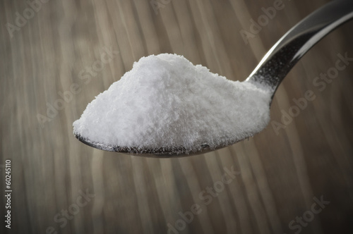 Iron spoon of baking soda close up